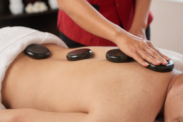 Performance of a Hot Stone Massage on back of the body